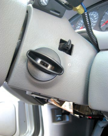 The ignition switch of my 2003 Ford Mustang GT functions similar to those on most older cars. Turn the switch back toward the driver to select the accessory position.
